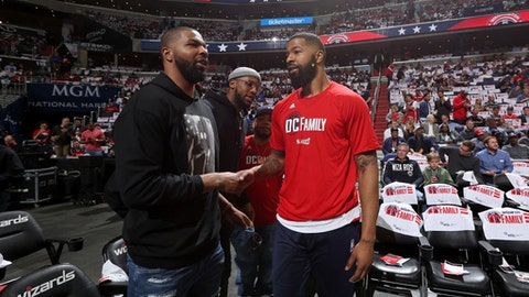 WASHINGTON, DC - APRIL 19:  Marcus Morris #13 of the Detroit Pistons and Markieff Morris #5 of the Washington Wizards shake hands during Game Two of the Eastern Conference Quarterfinals during the 2017 NBA Playoffs on April 19, 2017 at Verizon Center in Washington, DC. NOTE TO USER: User expressly acknowledges and agrees that, by downloading and or using this Photograph, user is consenting to the terms and conditions of the Getty Images License Agreement. Mandatory Copyright Notice: Copyright 2017 NBAE (Photo by Stephen Gosling/NBAE via Getty Images)