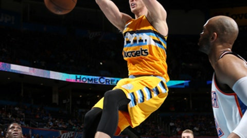 OKLAHOMA CITY, OK - APRIL 12: Mason Plumlee #24 of the Denver Nuggets dunks the ball during the game against the Oklahoma City Thunder on April 12, 2017 at Chesapeake Energy Arena in Oklahoma City, OK. NOTE TO USER: User expressly acknowledges and agrees that, by downloading and/or using this photograph, user is consenting to the terms and conditions of the Getty Images License Agreement. Mandatory Copyright Notice: Copyright 2017 NBAE (Photo by Layne Murdoch/NBAE via Getty Images)