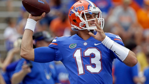 FILE - This Sept. 16, 2017 file photo shows Florida quarterback Feleipe Franks warming up before an NCAA college football game against Tennessee in Gainesville, Fla. Franks walked into his American History class and was handed a trophy. It was an award his professor gives students for asking really good questions in class. Franks got it for delivering the ultimate answer against Tennessee. Franks heaved a 63-yard touchdown pass to Tyrie Cleveland as time expired Saturday and gave Florida a 26-20 victory against the Volunteers. The redshirt freshman spent the last two days getting praised for a play that will go down in program lore. (AP Photo/John Raoux, file)