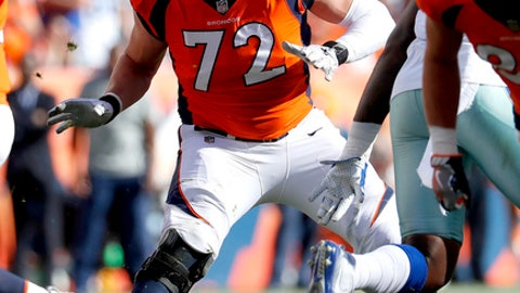 Denver Broncos offensive tackle Garett Bolles (72) competes against the Dallas Cowboys during the first half of an NFL football game, Sunday, Sept. 17, 2017, in Denver. Broncos coach Vance Joseph says rookie tackle Garett Bolles' left leg injury isn't as serious as first feared. Joseph says Bolles has a bone bruise in his lower left leg and is week to week. The Broncos' first-round draft pick was injured in Denver's win over Dallas. (AP Photo/Jack Dempsey)