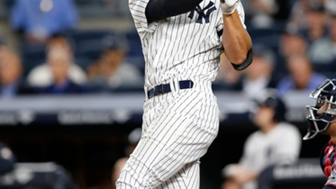 New York Yankees' Aaron Judge watches his solo home run during the first-inning of a baseball game against the Minnesota Twins in New York, Monday, Sept. 18, 2017. (AP Photo/Kathy Willens)