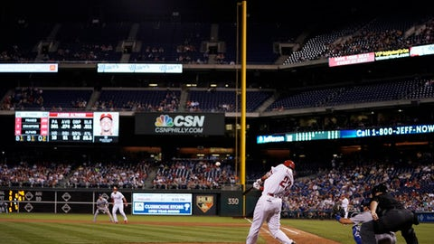 Philadelphia Phillies' Aaron Altherr hits a grand slam off Los Angeles Dodgers starting pitcher Clayton Kershaw during the sixth inning of a baseball game, Monday, Sept. 18, 2017, in Philadelphia. Philadelphia won 4-3. (AP Photo/Matt Slocum)