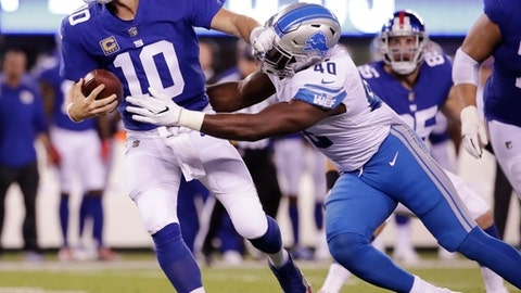 New York Giants quarterback Eli Manning (10) is sacked by Detroit Lions' Jarrad Davis (40) during the first half of an NFL football game, Monday, Sept. 18, 2017, in East Rutherford, N.J. (AP Photo/Julio Cortez)