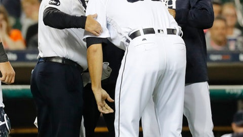 Detroit Tigers relief pitcher Jeff Ferrell (66) heads to the dugout with trainers and manager Brad Ausmus, right, after being hit by a Oakland Athletics' Ryon Healy line drive in the eighth inning of a baseball game in Detroit, Monday, Sept. 18, 2017. (AP Photo/Paul Sancya)