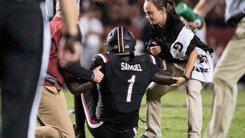 FILE - In this Saturday, Sept. 16, 2017, file photo, South Carolina wide receiver Deebo Samuel (1) is helped by trainers after an injury during the second half of an NCAA college football game against Kentucky in Columbia, S.C. South Carolina has 11 touchdowns its first three games, six of them by Samuel. Now, with Samuel sidelined with a left leg fracture, the Gamecocks need to find other players capable of stepping up and filling in for the dyanmic Samuel(AP Photo/Sean Rayford, File)
