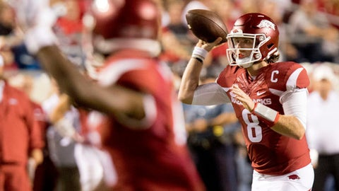 FILE - In this Aug. 31, 2017, file photo, Arkansas quarterback Austin Allen (8) throws the ball downfield during the first quarter of an NCAA college football game against Florida A&M, in Little Rock, Ark. Austin Allen emerged as one of the top quarterbacks in the Southeastern Conference last season in his first year as the starter for Arkansas. This year, the Razorbacks senior has struggled through two games _ but he plans to stop trying to be perfect and have fun this week against Texas A&M. (AP Photo/Gareth Patterson, File)