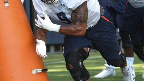 FILE - In this Aug. 2, 2017, file photo, Auburn defensive end Byron Cowart (9) works out during an NCAA college football practice in Auburn, Ala.  Cowart has left the program and been granted his release.  Coach Gus Malzahn confirmed Cowart's decision on Tuesday, Sept. 19, 2017, a day after he dismissed former starting quarterback Sean White from the team. (Julie Bennett /AL.com via AP, File)