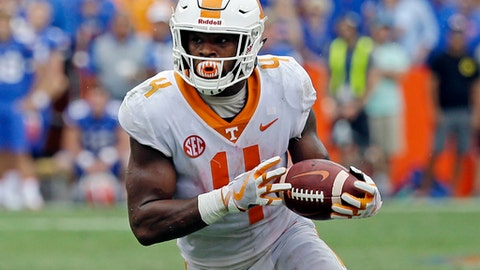 FILE- In this Saturday, Sept. 16, 2017, file photo, Tennessee running back John Kelly runs against Florida during the second half of an NCAA college football game in Gainesville, Fla. The Southeastern Conference has three of the four running backs on the Associated Press preseason All-America team. Yet three weeks into the season, the SEC's leading rusher is Tennessee's John Kelly. (AP Photo/John Raoux, File)