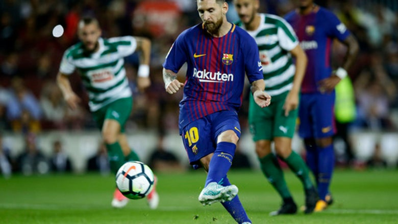 Messi nets 4 goals to keep Barcelona with perfect record