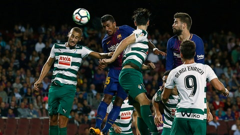 FC Barcelona's Paulinho, second left, heads the ball to score during the Spanish La Liga soccer match between FC Barcelona and Eibar at the Camp Nou stadium in Barcelona, Spain, Tuesday, Sept. 19, 2017. (AP Photo/Manu Fernandez)