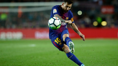 FC Barcelona's Lionel Messi kicks the ball during the Spanish La Liga soccer match between FC Barcelona and Eibar at the Camp Nou stadium in Barcelona, Spain, Tuesday, Sept. 19, 2017. (AP Photo/Manu Fernandez)