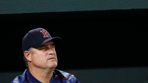 Boston Red Sox manager John Farrell stands in the dugout in the third inning of a baseball game against the Baltimore Orioles in Baltimore, Tuesday, Sept. 19, 2017. (AP Photo/Patrick Semansky)