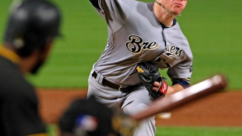 Milwaukee Brewers starting pitcher Chase Anderson delivers during the sixth inning of a baseball game against the Pittsburgh Pirates, Tuesday, Sept. 19, 2017 in Pittsburgh. (AP Photo/Gene J. Puskar)