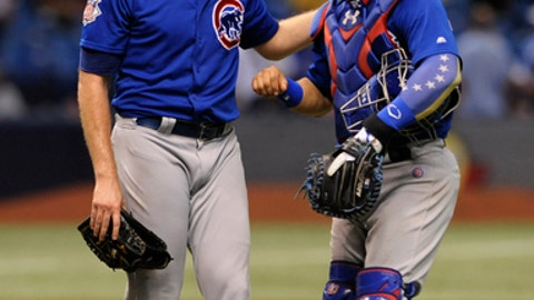 Chicago Cubs closer Wade Davis, left, and catcher Wilson Contreras celebrate a 2-1 win over the Tampa Bay Rays during a baseball game Tuesday, Sept. 19, 2017, in St. Petersburg, Fla. (AP Photo/Steve Nesius)