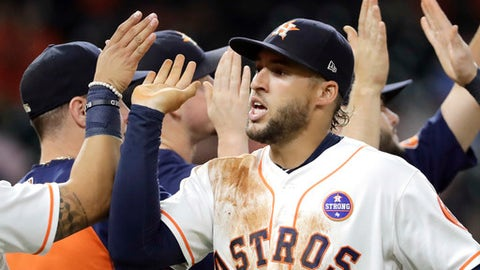 Houston Astros' George Springer celebrates with teammates after a baseball game against the Chicago White Sox Tuesday, Sept. 19, 2017, in Houston. The Astros won 3-1. (AP Photo/David J. Phillip)