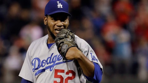 Los Angeles Dodgers relief pitcher Pedro Baez reacts after giving up a three-run double to Philadelphia Phillies' Rhys Hoskins during the seventh inning of a baseball game, Tuesday, Sept. 19, 2017, in Philadelphia. Philadelphia won 6-2. (AP Photo/Matt Slocum)