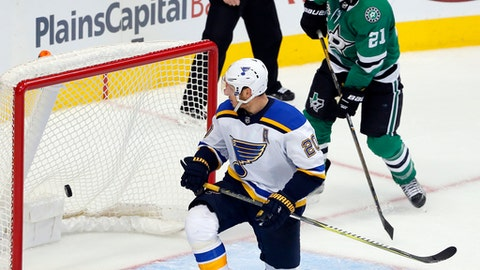 St. Louis Blues left wing Alexander Steen (20) and Dallas Stars left wing Antoine Roussel (21) of France, look back to see a empty net goal scored by Tyler Pitlick, not pictured, in the closing minutes of the third period of a preseason NHL hockey game, Tuesday, Sept. 19, 2017, in Dallas. (AP Photo/Tony Gutierrez)