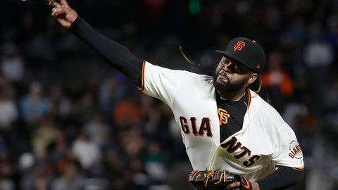 San Francisco Giants pitcher Johnny Cueto throws against the Colorado Rockies during the seventh inning of a baseball game in San Francisco, Tuesday, Sept. 19, 2017. (AP Photo/Jeff Chiu)