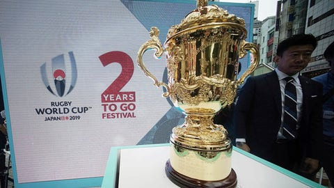 The Webb Ellis Cup is displayed at a promotional event for the 2019 Rugby World Cup at Shibuya district in Tokyo, Wednesday, Sept. 20, 2017. The trophy will be displayed in several cities in Japan to celebrate two years to go until the Rugby World Cup start in Japan from Sept. 20 to Nov. 2. (AP Photo/Eugene Hoshiko)