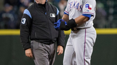 Texas Rangers' Carlos Gomez celebrates hitting a double off of Seattle Mariners pitcher Nick Vincent in the eighth inning of a baseball game Tuesday, Sept. 19, 2017, in Seattle. The Texas Rangers beat the Seattle Mariners 3-1. (AP Photo/Lindsey Wasson)