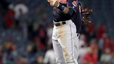Cleveland Indians center fielder Greg Allen, left, and shortstop Francisco Lindor celebrate after their 6-3 win against the Los Angeles Angels after a baseball game in Anaheim, Calif., Tuesday, Sept. 19, 2017. (AP Photo/Chris Carlson)