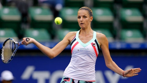 Karolina Pliskova of the Czech Republic returns a shot to Magda Linette of Poland during their second round match of the Japan Pan Pacific Open tennis tournament in Tokyo, Wednesday, Sept. 20, 2017. (AP Photo/Shizuo Kambayashi)