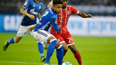 Schalke's Weston McKennie of the USA, left, and Bayern's Kingsley Coman challenge for the ball during the German Bundesliga soccer match between FC Schalke 04 and Bayern Munich at the Arena in Gelsenkirchen, Germany, Tuesday, Sept. 19, 2017. McKennie made his first Bundesliga start. (AP Photo/Martin Meissner)