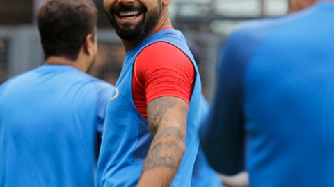 Indian cricket captain Virat Kohli attends a practice session on the eve of their second one-day international match against Australia in Kolkata, India, Wednesday, Sept. 20, 2017. (AP Photo/Bikas Das)
