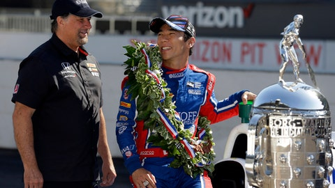 FILE - In this May 29, 2017, file photo, Indianapolis 500 champion Takuma Sato, of Japan, and car owner Michael Andretti chat during the traditional winners photo session on the start/finish line at the Indianapolis Motor Speedway in Indianapolis. Sato will return to Rahal Letterman Lanigan Racing next season. Sato spent just one season with Andretti Autosport and became the first Japanese winner of the 500. (AP Photo/Michael Conroy, File)