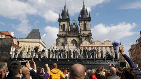 Tennis players and tennis legends representing teams of Europe and the World gather for a welcome ceremony of the Laver Cup at the Old Town square in Prague, Czech Republic, Wednesday, Sept. 20, 2017. The competition will pit a team of the best six European players against the top six from the rest of the world. The inaugural edition is scheduled for Sept. 22-24 at the O2 Arena in Prague. The Laver Cup is named after the Australian tennis legend Rod Laver. (AP Photo/Petr David Josek)