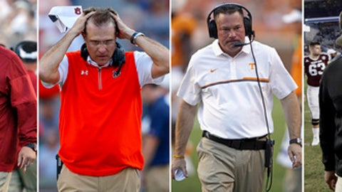 FILE - These are file photos showing NCAA college football coaches, from left, Arkansas head coach Bret Bielema, Auburn head coach Gus Malzahn, Tennessee head coach Butch Jones and Texas A&M coach Kevin Sumlin. The Southeastern Conference coaches who entered the season with questions about their job security haven't done much to quiet them. In fact, the heat from fans has intensified. (AP Photo/File)