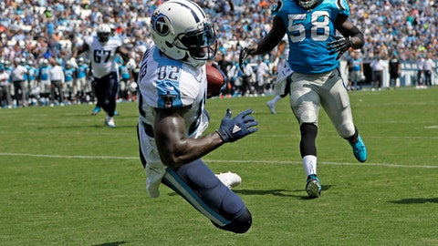 FILE - In this Aug. 19, 2017, file photo, Tennessee Titans tight end Delanie Walker (82) catches a 4-yard touchdown pass ahead of Carolina Panthers outside linebacker Thomas Davis (58) in the first half of an NFL preseason football game in Nashville, Tenn. A change in teams has been very beneficial to two-time Pro Bowler Delanie Walker. Thanks to four very productive seasons since joining Tennessee, Walker needs just 49 yards to become the seventh active tight end with 5,000 yards receiving for his career. (AP Photo/James Kenney, File)