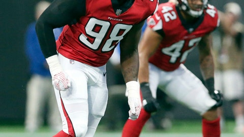 FILE - In this Aug. 26, 2017, file photo, Atlanta Falcons defensive end Takkarist McKinley (98) works against the Arizona Cardinals during the first half of an NFL football game in Atlanta.  With 2016 NFL sacks leader Vic Beasley out with a hamstring injury, rookie first-round pick Takk McKinley will move into the starting lineup for Sunday's game at Detroit. (AP Photo/John Bazemore, File)
