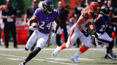 FILE - In this Sunday, Sept. 10, 2017, file photo, Baltimore Ravens defensive back Brandon Carr (24) runs the ball during the first half of an NFL football game against the Cincinnati Bengals in Cincinnati. The Ravens head to London this week to take on Jacksonville Jaguars on Sunday at Wembley Stadium.  (AP Photo/Gary Landers, File)