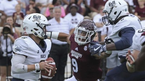 Mississippi State linebacker Montez Sweat (9) prepares to sack Charleston Southern quarterback Shane Bucenell (6) during the first half of an NCAA college football game in Starkville, Miss., Saturday, Sept. 2, 2017. (AP Photo/Jim Lytle)