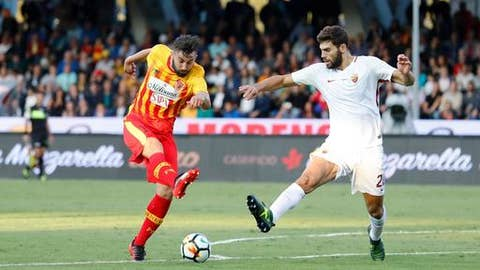 Benevento's Massimo Coda, left, and Roma's Federico Fazio vie for the ball during the Italian Serie A soccer match between Benevento and AS Roma at the Ciro Vigorito stadium in Benevento, Italy, Wednesday, Sept. 20, 2017. (Mario Taddeo/ANSA via AP)