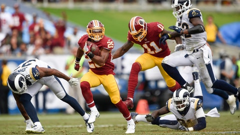 FILE - In this Sept. 17, 2017, file photo, Washington Redskins running back Chris Thompson (25) carries the ball against the Los Angeles Rams during the first half of an NFL football game, in Los Angeles. With DeSean Jackson and Pierre Garcon gone and defenses focused on stopping Jordan Reed, the Redskins have a not-so-secret weapon in the running and passing games in third-down back Chris Thompson, who could have an even bigger role against the Oakland Raiders (AP Photo/Kelvin Kuo, File)