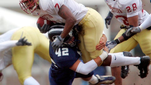 Midwestern State's Marcus Davis (7) is tripped up by Colorado School of Mines safety Tim Miller (42) during a kick return in the first half of a first-round NCAA division II playoff game in Golden, Colo., Saturday, Nov. 13, 2004. (AP Photo/Jack Dempsey)