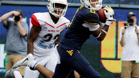 FILE - In this Sept. 16, 2017, file photo, West Virginia wide receiver Marcus Simms (8) makes a touchdown catch during the first half of an NCAA college football game against Delaware State, in Morgantown, W.Va. Just in time for the start of the Big 12 season, Marcus Simms has given the Mountaineers a reliable kick and punt returner while also providing a burst of speed on pass catching routes. Simms, who has three touchdown receptions in two games, will be on display again Saturday when West Virginia (2-1) plays at Kansas (1-2). (AP Photo/Raymond Thompson, File)
