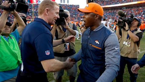 FILE - In this Sunday, Sept. 17, 2017, file photo, Dallas Cowboys head coach Jason Garrett, left, greets Denver Broncos head coach Vance Joseph after an NFL football game in Denver. In what could be a bounce-back season, Denver swept its first two home games, including a romp past Dallas. They head to Buffalo on Sunday, not the toughest place to play, especially in September, but an away game nonetheless. (AP Photo/Joe Mahoney, File)