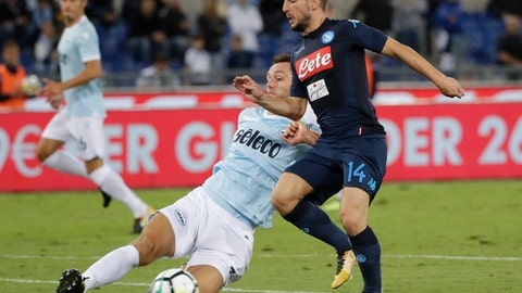 Lazio's Stefan de Vrij, left, and Napoli's Dries Mertens vie for the ball during a Serie A soccer match between Lazio and Napoli, at the Rome Olympic stadium, Wednesday, Sept. 20, 2017. (AP Photo/Alessandra Tarantino)