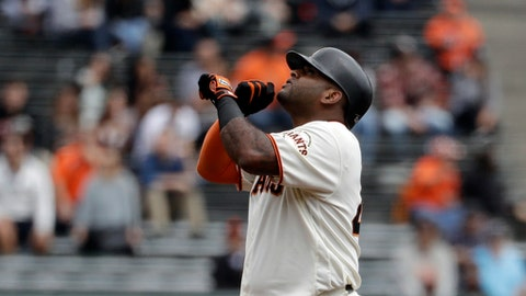 San Francisco Giants' Pablo Sandoval points skyward as he stands on second base with a double during the second inning of a baseball game against the Colorado Rockies, Wednesday, Sept. 20, 2017, in San Francisco. (AP Photo/Marcio Jose Sanchez)