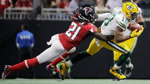 FILE - In this Sunday, Sept. 17, 2017 file photo, Green Bay Packers wide receiver Randall Cobb (18) makes the catch against Atlanta Falcons cornerback Desmond Trufant (21) during the first of an NFL football game in Atlanta. The banged-up Green Bay Packers are starting practice this week with about a dozen players on the injury report. Receivers Jordy Nelson and Randall Cobb, along with defensive lineman Mike Daniels were among the notable Packers who left last week's 34-23 loss to Atlanta with injuries. Coach Mike McCarthy spoke broadly about the injuries before practice on Wednesday, Sept. 20, 2017. (AP Photo/David Goldman, File)