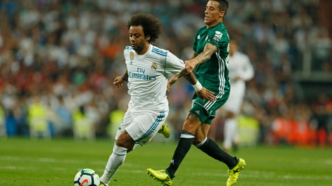 Real Madrid's Marcelo, left, vies for the ball with Betis' Antonio Barragan during the Spanish La Liga soccer match between Real Madrid and Real Betis at the Santiago Bernabeu stadium in Madrid, Wednesday, Sept. 20, 2017. (AP Photo/Francisco Seco)