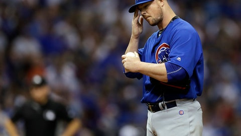 Chicago Cubs starting pitcher Jon Lester wipes his forehead as he struggles against the Tampa Bay Rays during the fifth inning of a baseball game Wednesday, Sept. 20, 2017, in St. Petersburg, Fla. Lester was removed later in the inning. (AP Photo/Chris O'Meara)