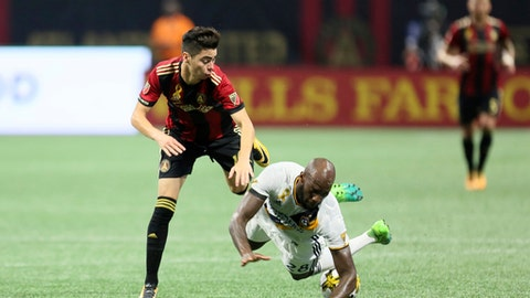 Atlanta United midfielder Miguel Almiron, left, goes for the ball against LA Galaxy defender Michael Ciani (28) during a MLS soccer game, Wednesday, Sept. 20, 2017 in Atlanta. (MIguel Martinez/Atlanta Journal-Constitution via AP)