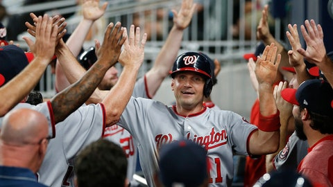 Washington Nationals first baseman Ryan Zimmerman (11) celebrates in the dugout after scoring on a two-run single by Adam Lind in the eighth inning of a baseball game against the Atlanta Braves Wednesday, Sept. 20, 2017, in Atlanta. (AP Photo/John Bazemore)
