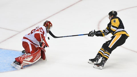 Pittsburgh Penguins' Justin Schultz scores the game winning goal against Detroit Red Wings' Tom McCollum in overtime of an NHL preseason hockey game Wednesday, Sept. 20, 2017, in Pittsburgh. (AP Photo/Fred Vuich)