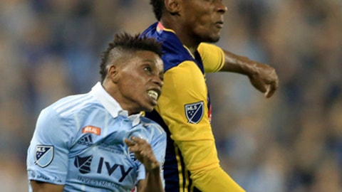 Sporting Kansas City forward Latif Blessing (9) and New York Red Bulls defender Michael Murillo, back, head the ball during the first half of the final of the U.S. Open Cup soccer tournament in Kansas City, Kan., Wednesday, Sept. 20, 2017. (AP Photo/Orlin Wagner)