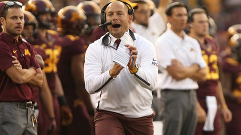 FILE - In this Aug. 31, 2017, file photo, Minnesota coach P.J. Fleck calls out a timeout during an NCAA college football game against Buffalo in Minneapolis. Minnesota is off until its Big Ten opener at home against Maryland Saturday, Sept. 30, 2017. The Gophers also were unbeaten through three games last season, but this year's accomplishment seems greater.  (AP Photo/Stacy Bengs, File)
